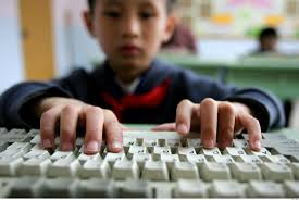 kid on a keyboard